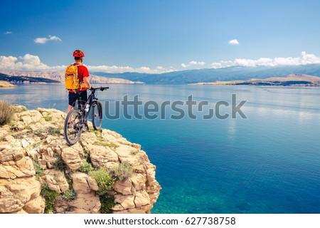 Mountain biker looking at view on bike trail in autumn mountains stock photo © blasbike