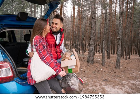 couple standing by car holding recycling stock photo © is2