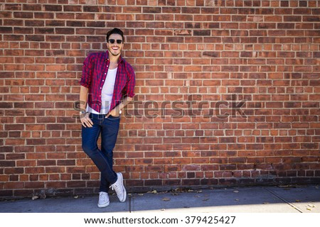 Stock photo: portrait of relaxed young man wearing a shirt with plaids