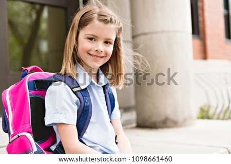 portrait of cute girl with backpack outside of school stock photo © lopolo