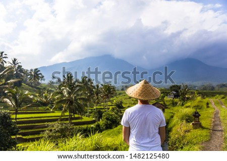 Man with traditional balinese cap at rice fields of Jatiluwih in Stock photo © boggy
