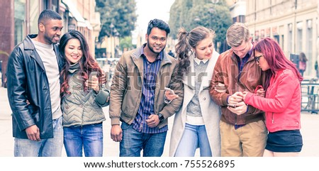 Couple with different ethnicities having a autumn walk in the park Stock photo © Kzenon