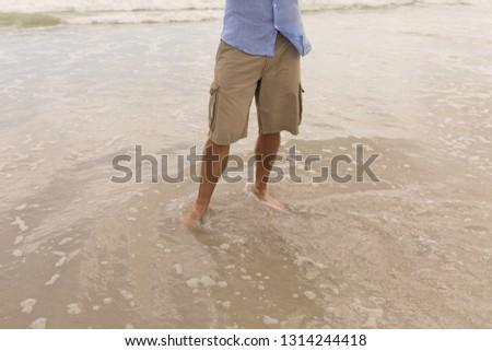 男 立って 海 水 短い ストックフォト © wavebreak_media