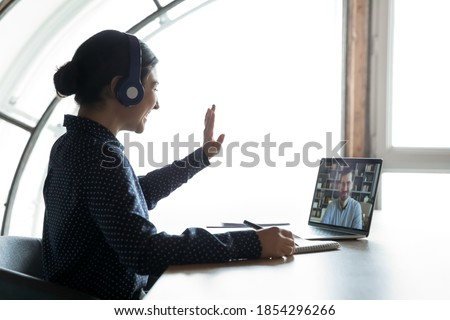 Cheerful female business worker calls partner to discuss details of statrup project, holds paper doc Stock photo © vkstudio