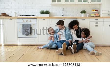 Renovating and remodeling house. Mother and daughter sit together on floor, have rest after painting Stock photo © vkstudio