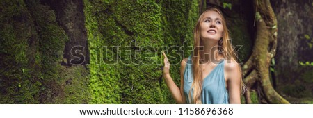 Young woman traveler in a Balinese garden overgrown with moss. Travel to Bali concept Stock photo © galitskaya