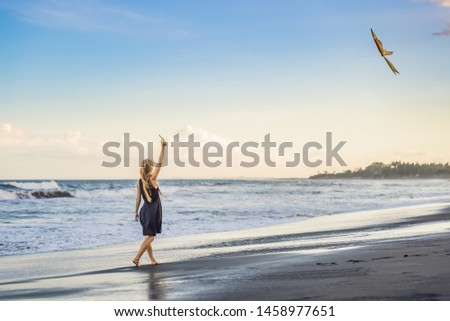 A young woman launches a kite on the beach. Dream, aspirations, future plans BANNER, LONG FORMAT Stock photo © galitskaya
