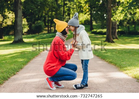 Portrait of mother and daughter keep noses closely to each other Stock photo © vkstudio