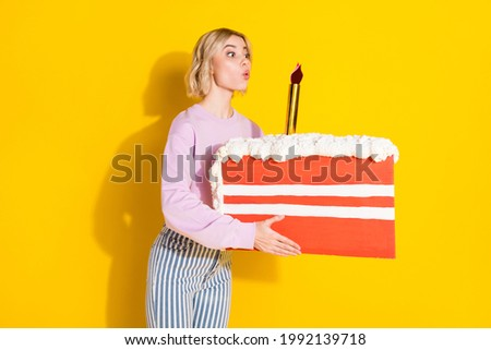 Photo of excited charming girl holding cake and expressing surprise Stock photo © deandrobot