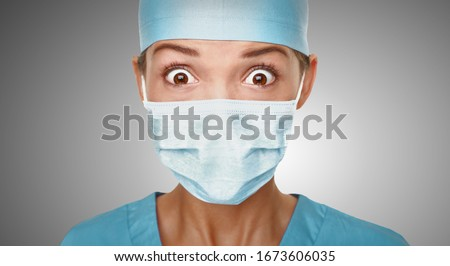 Virus scare Asian doctor woman shocked wearing coronavirus mask protection looking scared. China hos Stock photo © Maridav