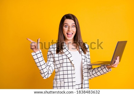 Photo of excited woman expressing surprise and pointing finger aside Stock photo © deandrobot