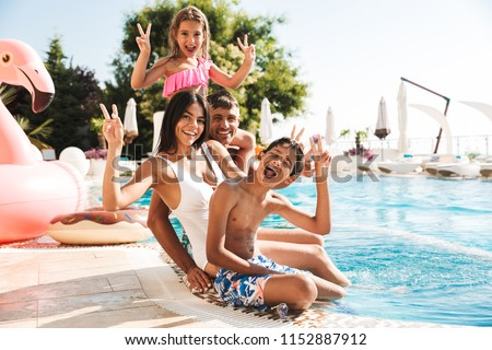 Luxury resort swimming pool. Happy family tourists relaxing in holiday retreat on summer travel vaca Stock photo © galitskaya