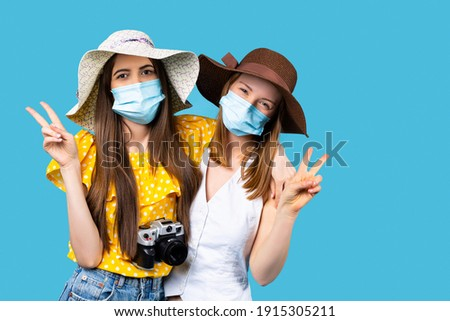 Young woman in medical mask traveler in the background of Pura Taman Kemuda Saraswati Temple in Ubud Stock photo © galitskaya