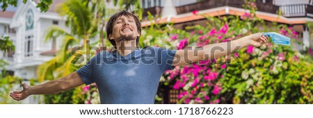 Quarantine is over concept. Man taking off mask against the background of small town houses. We are  Stock photo © galitskaya