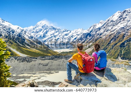 Backpackers couple hiking looking at Mount Cook view on mountains tramping in New Zealand. People hi Stock photo © Maridav