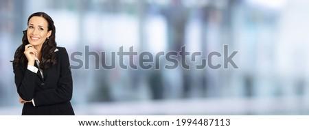 composite image of smiling thoughtful businesswoman stock photo © wavebreak_media