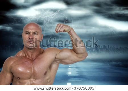 composite image of portrait of muscular man flexing bicep stock photo © wavebreak_media