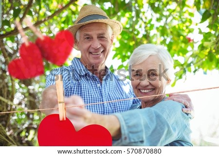 composite image of red heart and senior couple embracing on sofa stock photo © wavebreak_media