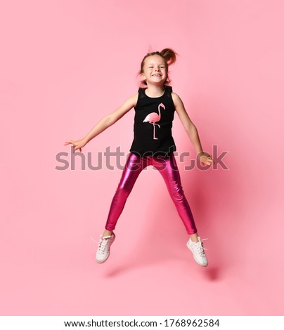 adorable little girl in pink shirt black trousers and glasses holds empty poster stock photo © traimak