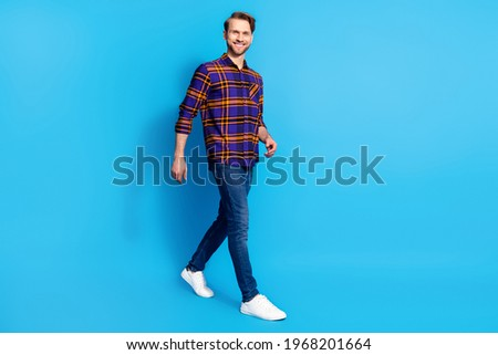 casual man wearing shirt with checkers walking confidently Stock photo © feedough