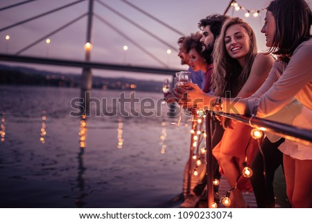 happy friends with champagne glasses at party Stock photo © dolgachov
