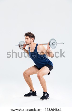 young man doing workouts on a back with power exercise machine i stock photo © boggy