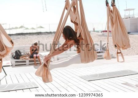 mooie · vrouw · verloofd · yoga · buitenshuis · zee · strand - stockfoto © ElenaBatkova