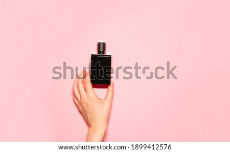 Minimalist fashion and beauty photo. Hand holding a pink balloon on a white wall background with sha Stock photo © serdechny