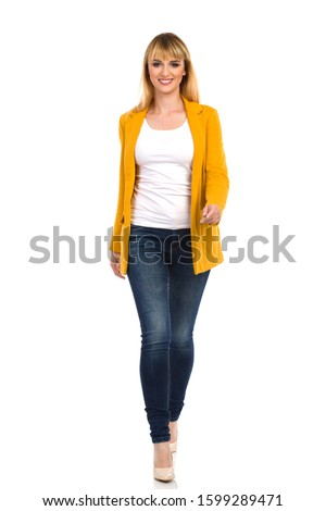 Front view of blonde Caucasian businesswoman looking and thinking while standing on stage in auditor Stock photo © wavebreak_media