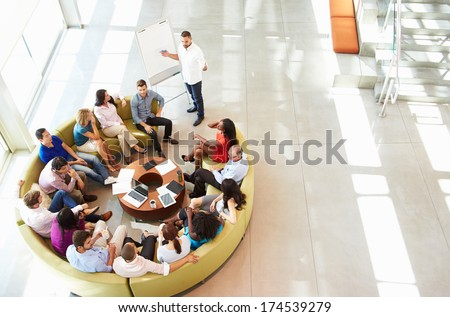 High angle view of Multi-ethnic business people working on computer at desk in modern office Stock photo © wavebreak_media