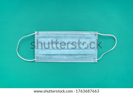 COVID-19 face masks top view on hospital teal medical blue background. Single use earl loop facial s Stock photo © Maridav