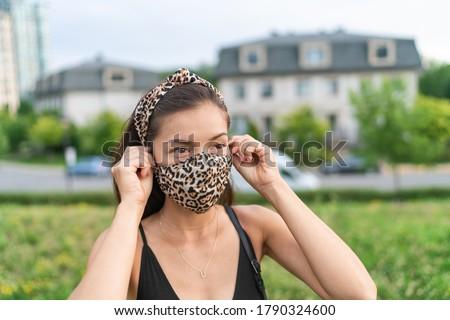 アジア 女性 顔 マスク 着用 ヒョウ ストックフォト © Maridav