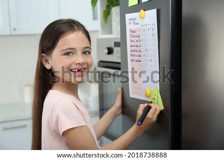 Girl drawing checks day Stock photo © OleksandrO