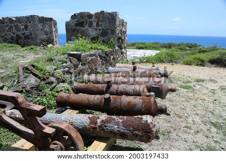 Old cannon rusting on St Martin Caribbean Stock photo © backyardproductions