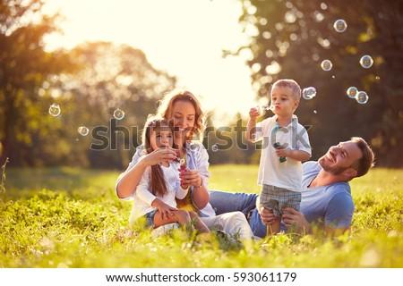 Mutlu aile genç aile çayır kadın Stok fotoğraf © val_th