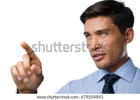 Businessman using invisible touchscreen against a white background Stock photo © wavebreak_media