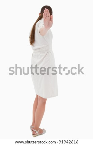 Portrait of a businesswoman turning her back while signing stop against a white background Stock photo © wavebreak_media