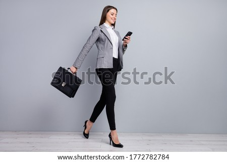 Profile of a businesswoman with a suitcase and holding a coffee against white background stock photo © wavebreak_media