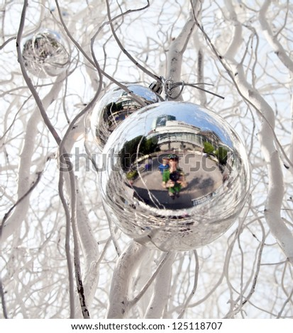 Stock photo: christmas tree balls and mirroring of father and sun with fun