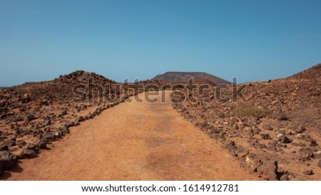 Road through lava rocks and volcanic mountains. Los Hervideros.  Stock photo © meinzahn