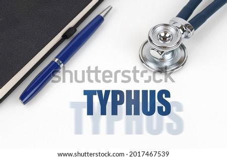 Typhus on the Display of Medical Tablet. Stock photo © tashatuvango