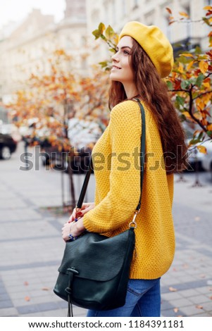 Beautiful young lady outdoors in casual cloths looking at camera Stock photo © deandrobot