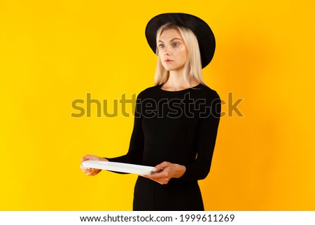 Young blonde girl in black dress with poster isolated on white Stock photo © Elnur