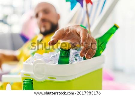Man Grabs Frozen Drink Stock photo © jackethead