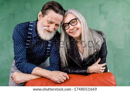 beautiful casual man posing while woman smiles and touches his s Stock photo © feedough