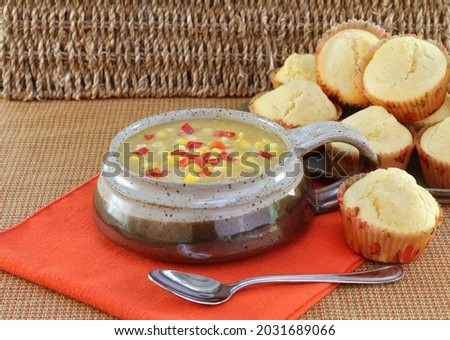 Delicious corn chowder and corn muffins. Stock photo © rojoimages