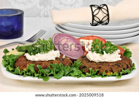 Black bean vegetarian burgers with a goat cheese topping. Stock photo © rojoimages