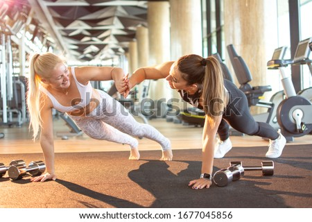 Trainer and girl giving high five to each other during obstacle course training Stock photo © wavebreak_media