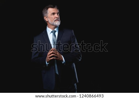 Portrait of confident handsome ambitious smiling elegant responsible businessman with thumb up on bl Stock photo © Traimak