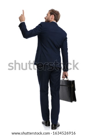 above view of young businessman pointing and showing something stock photo © boggy